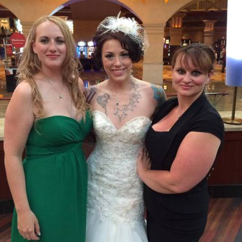 The Psych Major and I standing with the gorgeous bride.